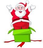 Santa salta da caixa de presente Fotografia de Stock
