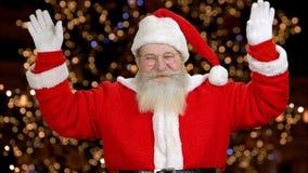 Santa is saluting. Orange darked back lights stock video footage