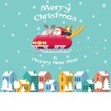 Santa sania latający samochód nad zimy miasteczkiem Obrazy Stock