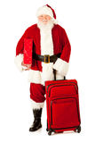 Santa: Santa With Gift and Luggage Stock Images