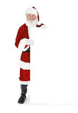 Santa: Santa Standing Behind White Card fotografia de stock
