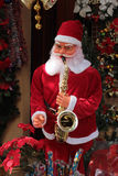 Santa With Sax. A Santa figure playing the saxophone Stock Photo