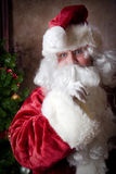 Santa says Quiet Now. Santa with finger to lip signaling shhhh stock images