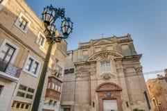 Santa Scholastica kyrka i Vittoriosa (Birgu), Malta Fotografering för Bildbyråer