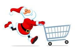 Santa se ejecuta con el carro de compras Foto de archivo libre de regalías