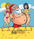 Santa at the seaside Stock Image