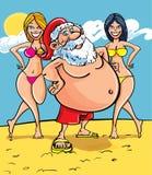 Santa at the seaside Stock Image