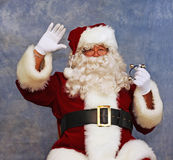 Santa sees the children and waves Stock Photo