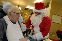 Santa and senior citizen Royalty Free Stock Photos