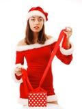 Santa 'sexy' que amarra acima de um presente de Natal Imagens de Stock