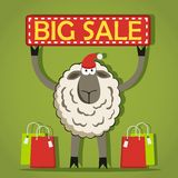 Santa Sheep mit großer Verkaufsfahne Stockfoto