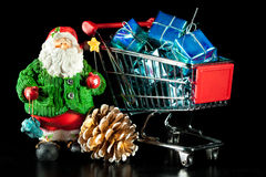 Santa and shopping cart Stock Image