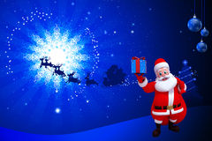 Santa showing a blue gift box Royalty Free Stock Photos