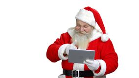 Santa is showing his thumb up to the tablet. stock footage