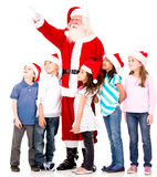 Santa showing something to the kids Stock Photos