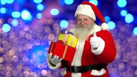 Santa showing thumb up, presents. stock video