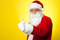 Santa showing thumbs up gesture to camera Royalty Free Stock Images