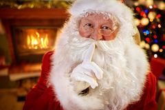 Santa showing to be silent gesture Stock Images