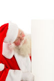 Santa with a sign to the side Stock Images