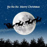 Santa silhouette night scene on full blue moon Stock Photography