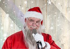 Santa singing christmas song on microphone Stock Images