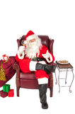 Santa sipping Royalty Free Stock Photo