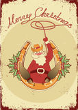 Santa sit on horseshoe with cowboy lasso Stock Image