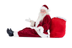 Santa sits leaned on his bag and has no clue Stock Photo