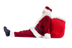 Santa sits leaned on his bag Stock Image