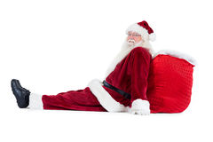 Santa sits leaned on his bag Stock Photography