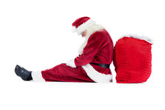 Santa sits leaned on his bag Royalty Free Stock Photo