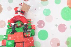 Santa sitting at big gift boxes and reading wish list. Santa sitting at the top of many big gift boxes and reading wish list. Black Friday 2017 at United States Stock Photography