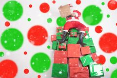 Santa sitting at big gift boxes and reading wish list. Santa sitting at the top of many big gift boxes and reading wish list. Black Friday 2017 at United States Royalty Free Stock Photo
