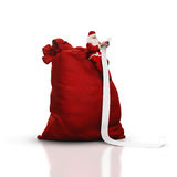 Santa sitting on big sack and reading long list Royalty Free Stock Photo