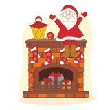 Santa sitting on chimney Stock Photo