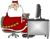 Santa Sitting At A Computer Royalty Free Stock Photography