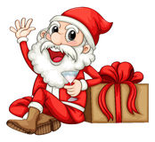 Santa sitting beside a gift Royalty Free Stock Photo