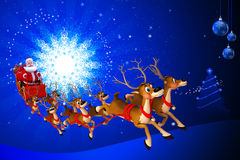 Santa sitting in his sleigh coming towards us Royalty Free Stock Image