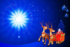Santa sitting in his sleigh before moon Stock Photo