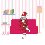 Santa sitting in living room Royalty Free Stock Photography