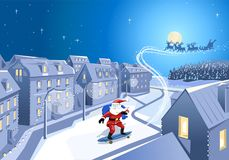 Santa skateboarding in city street stock image