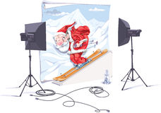 Santa the skier. Santa-skier is in the photo studio. The photographer is taking a picture of him Royalty Free Stock Images