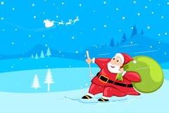 Santa sking in snow Royalty Free Stock Photo