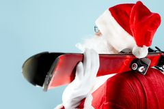 Santa with skis Royalty Free Stock Photo