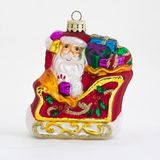 Santa Ornament on sled. Santa on sled with gifts ornament on white background Royalty Free Stock Images