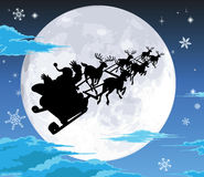 Santa in sled silhouette against full moon Stock Images