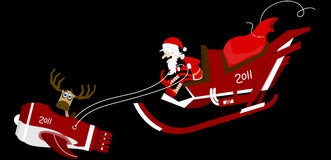 Santa on sledge Stock Photos