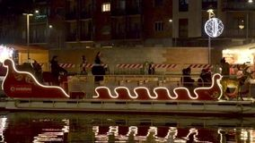 Santa sledge boat at Darsena Xmas market , Milan, Italy stock video footage