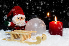 Santa with sledge in the snow Stock Image