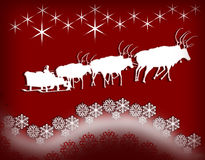 Santa on sledgeof reindeers on red Stock Photo